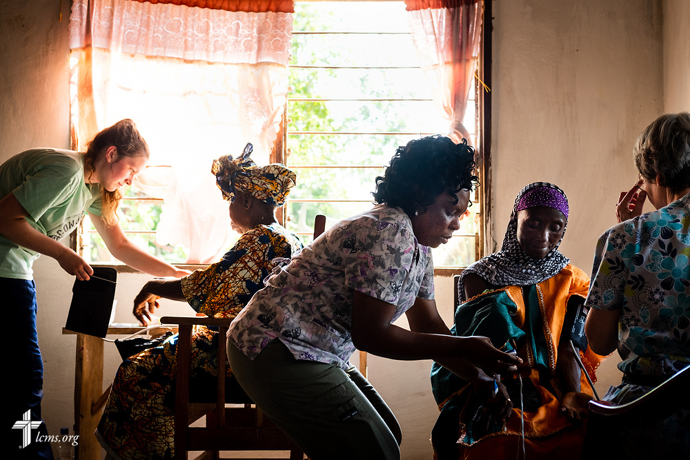 Patients are seen for vitals on the second day of the LCMS Mercy Medical Team on Tuesday, May 8, 2018, in the Yardu village outside Koidu, Sierra Leone, West Africa. LCMS Communications/Erik M. Lunsford