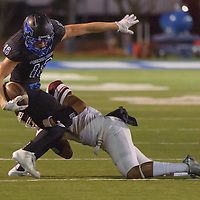 Friendswood #18 Joey Crespo is tackled by Clear Creek #1 Colby Burton during the game at Winston Stadium in Friendswood 10/17/14