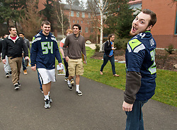 Brandon Jamison leads a tour group on Seahawks Blue Friday at PLU on Friday, Jan. 30, 2015. (Photo/John Froschauer)