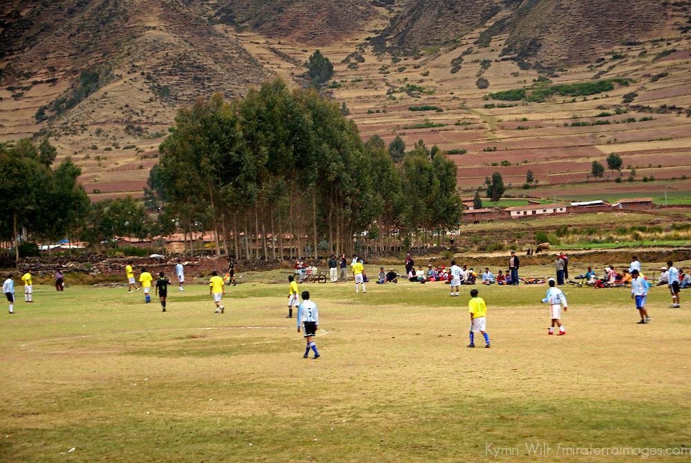 South America, Peru, Cusco. Football (soccer) game in the Urubamba Valley outside Cusco.