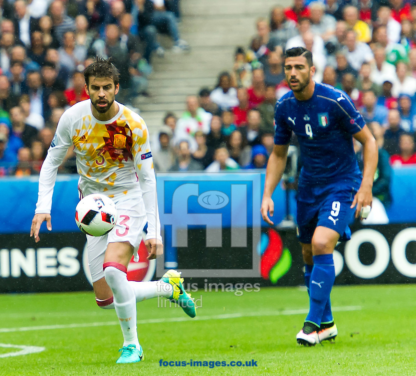 Giorgio Chiellini of Italy and Lucas Vazquez of Spain during the UEFA Euro 2016 match at Stade de France, Paris<br /> Picture by Anthony Stanley/Focus Images Ltd 07833 396363<br /> 27/06/2016