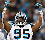 CHARLOTTE, NC - JAN 24:  Defensive end Charles Johnson #95 of the Carolina Panthers gestures to the crowd during the NFC Championship game against the Arizona Cardinals at Bank of America Stadium on January 24, 2016 in Charlotte, North Carolina.