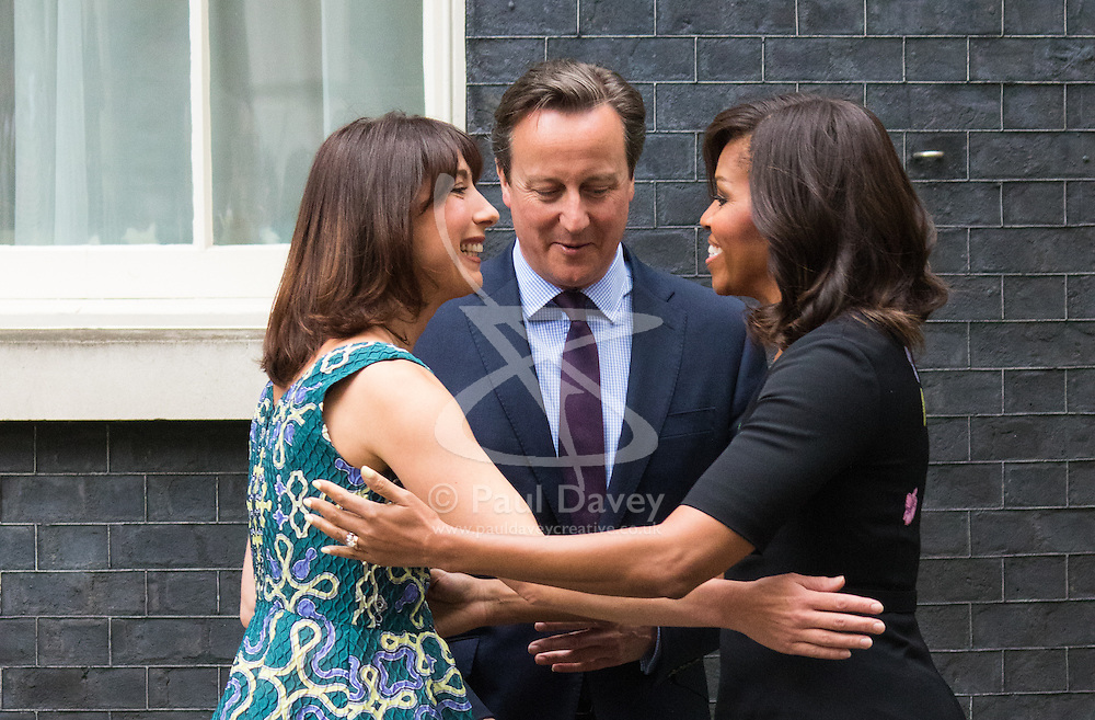 Downing Street, London, June 16th 2015. United States First Lady Michelle Obama arrives at the home of British Prime Minister David Cameron where she will be meeting with both the PM and his wife Samantha. She is being accompanied on her trip by her mother Marian Robinson and two daughters Sasha and Malia.