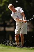 Ryan Brehm of Mount Pleasant chips up to the 10th green during  semi-final play at the Michigan Amateur Golf Championship at Boyne Highlands in Harbor Springs.