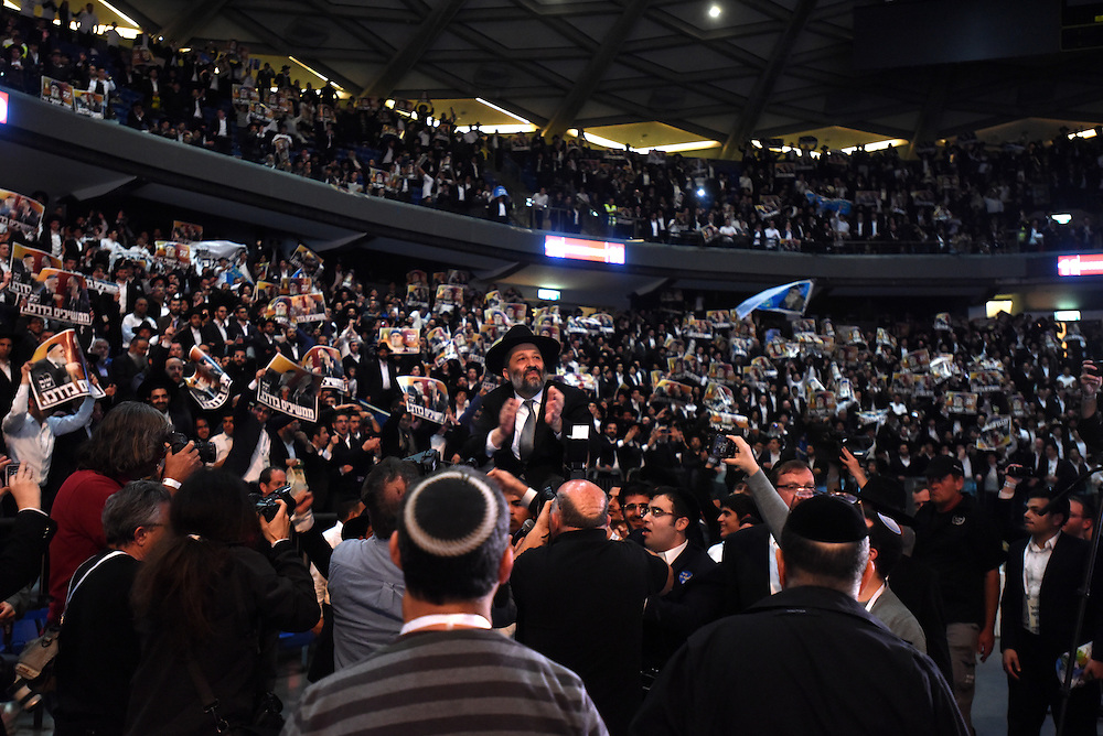 Ariye Deri, leader of Shas Party, is carried by supporters of during the party's rally in  Tel Aviv, March 3, 2015. Some 10,000 supporters of the Ultra-Orthodox Shas Party gathered on the Nokia Stadium in Tel Aviv for the party's election campaign largest rally. Photo by Gili Yaari
