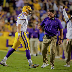 Oct 12, 2019; Baton Rouge, LA, USA; LSU Tigers quarterback Joe Burrow (9) celebrates with head coach Ed Orgeron after a touchdown during the fourth quarter against the Florida Gators at Tiger Stadium. Mandatory Credit: Derick E. Hingle-USA TODAY Sports