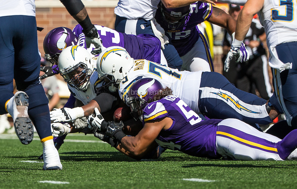 Sep 27, 2015; Minneapolis, MN, USA; Minnesota Vikings linebacker Eric Kendricks (54) and San Diego Chargers offensive tackle Chris Hairston (75) dive for a fumble during the first quarter at TCF Bank Stadium. Mandatory Credit: Brace Hemmelgarn-USA TODAY Sports