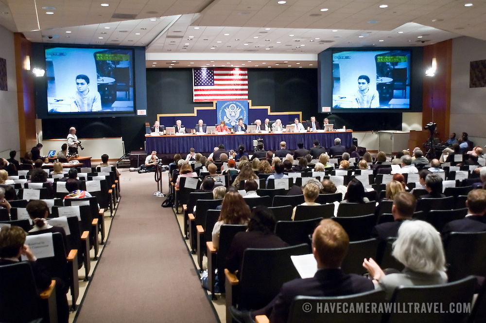 """Commission staffers present Staff Statement No. 16, """"Outline of the 9/11 Plot."""" On the screen is security camera footage of Mohamed Atta. The 9/11 Commission's 12th public hearing on """"The 9/11 Plot"""" and """"National Crisis Management"""" was held June 16-17, 2004, in Washington, DC."""