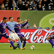 David Villa, NYCFC, is sandwiched by Darwin Ceren, (left) and Tommy Redding, as Seb Hines, (right), Orlando, tackles during the New York City FC Vs Orlando City, MSL regular season football match at Yankee Stadium, The Bronx, New York,  USA. 18th March 2016. Photo Tim Clayton