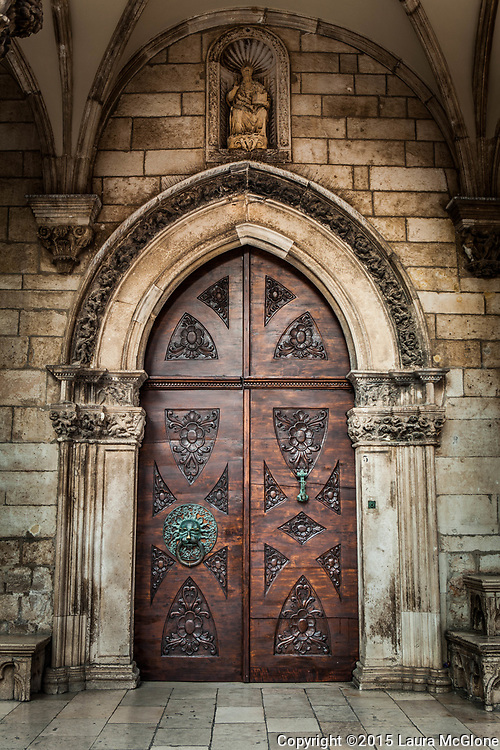 Doorway in Croatia, Brown carved with Stone Surround
