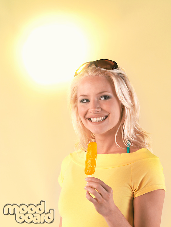 Woman holding popsicle on hot Summer Day