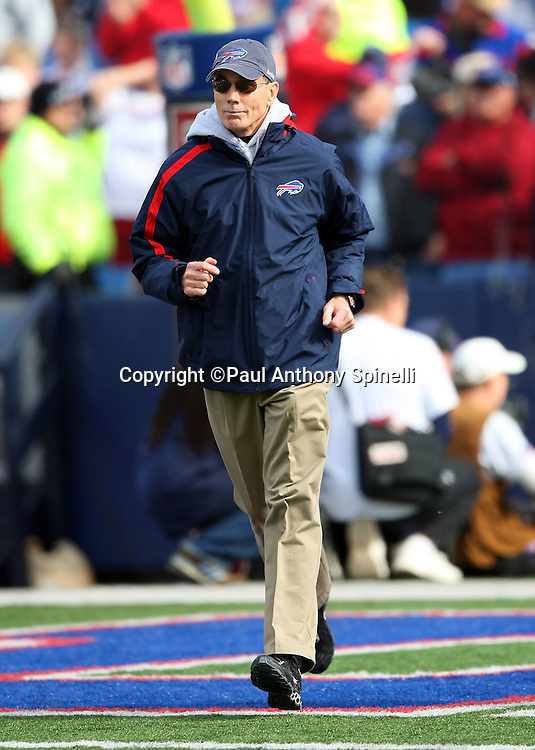 Buffalo Bills Head Coach Dick Jauron jogs onto the field for the NFL football game against the Houston Texans, November 1, 2009 in Orchard Park, New York. The Texans won the game 31-10. (©Paul Anthony Spinelli)