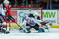 KELOWNA, BC - DECEMBER 30: Roman Basran #30 of the Kelowna Rockets makes a first period glove save against the Prince George Cougars  at Prospera Place on December 30, 2019 in Kelowna, Canada. (Photo by Marissa Baecker/Shoot the Breeze)