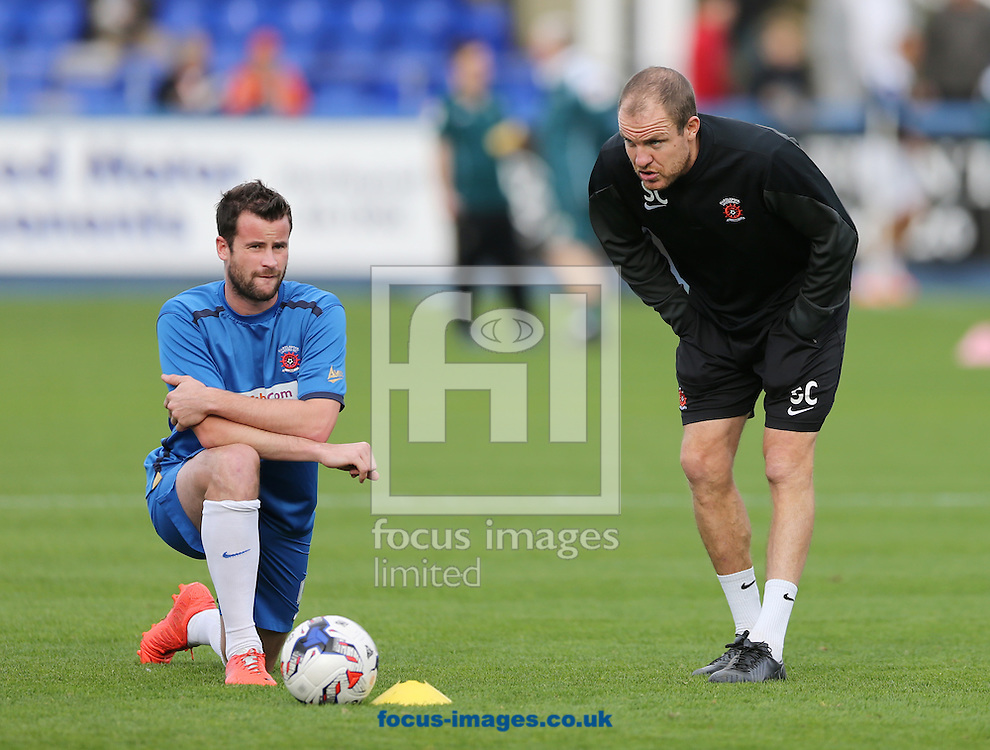 Hartlepool United joint caretaker manager Sam Collins (r) talks to Matthew Bates prior to the Sky Bet League 2 match at Victoria Park, Hartlepool<br /> Picture by Simon Moore/Focus Images Ltd 07807 671782<br /> 18/10/2014