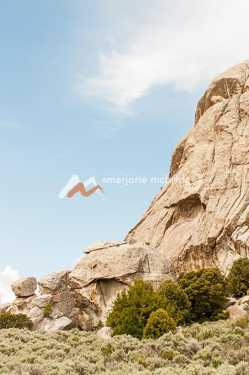 Tiny climber climbing in distance. City of Rocks National Preserve, Castle Rock. Idaho.