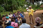 Community health worker Nancy Tucker, 42 years old old speaks to members of her village during a meeting to discuss household registration and other areas of focus including community profiling (how many latrines and if there is a water pump for example in the village) she was trained on recently in the village of Bambaya, Kono district, Sierra Leone on March 27, 2017. Nancy became a CHW in 2008 and has been providing maternal and child health related services to her community. &ldquo;As a CHW, I counsel pregnant women in my village about the importance of accessing ante-natal care services at the health facility and also giving birth there. I advise them to take all their vaccines. I also convince them to exclusively breastfeed their babies for at least six months after they give birth and educate them on good hygiene practices,&rdquo; she said.<br />  <br /> &ldquo;One thing I am proud of is helping to save the life of a bleeding pregnant woman and her baby. I acted fast and ensured we took her to the health center where she received help. Even though there was no car or motor bike I insisted that we go with her immediate and we carried her on a hammock. That woman and her baby might have died if I didn&rsquo;t intervene.&rdquo;
