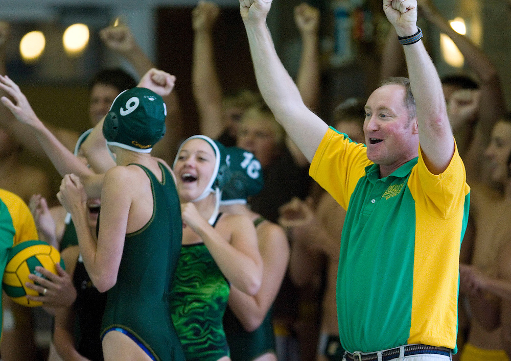 Kearns Head coach Brad Percy celebrates his girls team victory over Skyline in the 5A state water polo championships in Murray, Utah Saturday  May 5, 2007.  August Miller/ Deseret Morning News