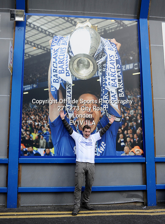 25/02/2012 - Barclays Premier League Football - 2011-2012 - Chelsea v Bolton Wanderers - A chelsea fan has his photo taken with a giant John Terry poster. - Photo: Charlie Crowhurst / Offside.