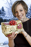 Young woman with Christmas present (model-released)