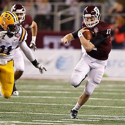 Jan 7, 2011; Arlington, TX, USA; Texas A&M Aggies quarterback Ryan Tannehill (17) runs as LSU Tigers linebacker Kelvin Sheppard (11) pursues during the second half of the 2011 Cotton Bowl at Cowboys Stadium.  Mandatory Credit: Derick E. Hingle