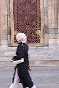 Mevlana Tekkesi Mosque in Konya (door behind carpet to enter mosque