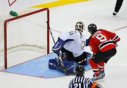 Nov 5, 2008; Newark, NJ, USA; New Jersey Devils left wing Zach Parise (9) hits the post during the overtime shootout at the Prudential Center. The Devils defeated the Lightning 4-3 in an OT shootout.