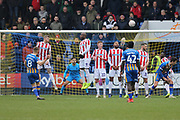 8 Greg Docherty for Shrewsbury Town shoots on goal during the The FA Cup 3rd round match between Shrewsbury Town and Stoke City at Greenhous Meadow, Shrewsbury, England on 5 January 2019.