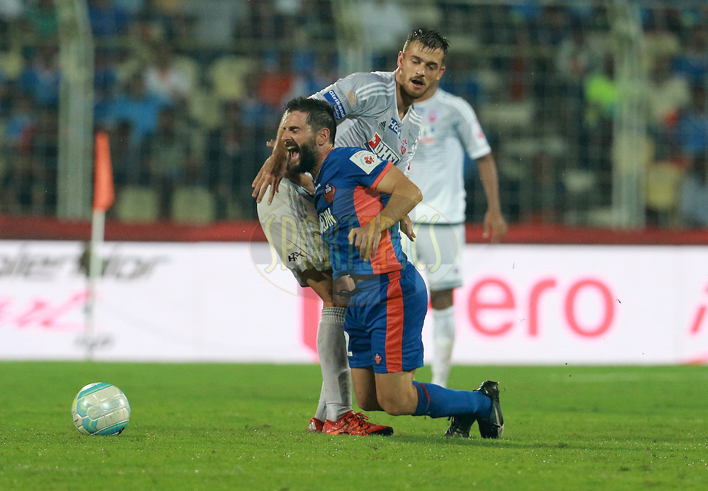Joffre Gonzalez of FC Goa collide with Jonatan Lucca of FC Pune City during match 8 of the Indian Super League (ISL) season 3 between FC Goa and FC Pune City held at the Fatorda Stadium in Goa, India on the 8th October 2016.<br /> <br /> Photo by Vipin Pawar / ISL/ SPORTZPICS