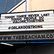 A marquee sign at the Beacham Theater encourages people to stay strong during a stay at home order that was issued by Orange County government on Friday, March 27, 2020 in Orlando, Florida.  (Alex Menendez via AP)