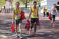 Runners with their goodie bags at the finish of the Virgin Money London Marathon 2014<br /> on Sunday 13 April 2014<br /> Photo: Dave Shopland/Virgin Money London Marathon<br /> media@london-marathon.co.uk