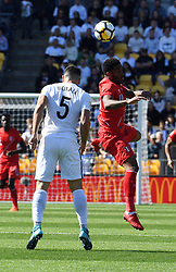 New Zealand's Michael Boxall, left, contests against  header with Peru's Jefferson Farfan in the Soccer World Cup qualifying match, Westpac Stadium, Wellington, New Zealand, Saturday, November 11, 2017. Credit:SNPA / Ross Setford  **NO ARCHIVING**