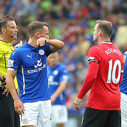 Manchester United's Wayne Rooney argues with Referee Mark Clattenburg during the Barclays Premiership match between Leicester City FC and Manchester United FC, at the King Power Stadium, Leicester, 21st September 2014 © Phil Duncan | SportPix.org.uk