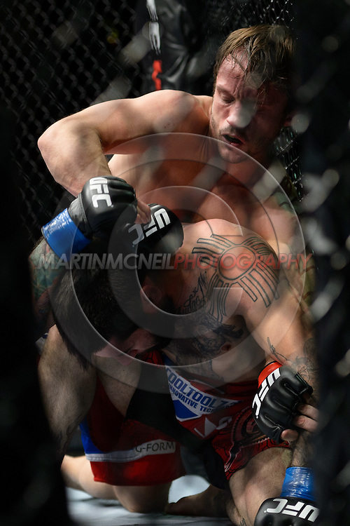"STOCKHOLM, SWEDEN, APRIL 14:  Brad Pickett (blue/red shorts) and Damacio Page (red shorts) during ""UFC on Fuel TV: Gustafsson vs. Silva"" inside the Ericsson Globe Arena in Stockholm, Sweden"