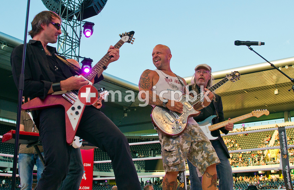 Swiss rockstar Goelae (C) and his band perform on stage prior to the world heavyweight championship title fight between titleholder Wladimir Klitschko of Ukraine and contender Tony Thompson of the United States at the Stade de Suisse soccer stadium in Bern, Switzerland, Saturday, July 7, 2012. (Photo by Patrick B. Kraemer / MAGICPBK)