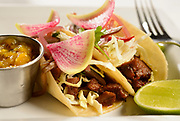 Joel Tate's beef tongue street tacos delight with locally-sourced beef, pickled jalapenos, onions, spicy mango salsa and watermelon radish.