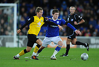 Football - League Cup Quarter Final - Cardiff City vs. Blackburn Rovers<br /> Blackburn Rovers Morten Gamst Pedersen and Aron Gunnarsson of Cardiff City in action at the Cardiff City Stadium