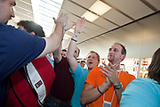 12 JUNE 2009 -- SCOTTSDALE, AZ: Shoppers file into the new Apple Store in Scottsdale, AZ, during its grand opening. The outlet will be Arizona's largest Apple Store, occupying nearly 10,000 square feet in the Outdoor Lifestyle Center in the Scottsdale Quarter. The store, the fifth in the Phoenix area, uses a radically different design from other Apple Stores in some respects. Ceilings in the building are approximately 20 feet high, and lined with a 75-foot long skylight, reducing dependence on artificial lighting. Aiding the skylight is an all-glass front and rear, permitting visitors to see directly through the store. More than one thousand people lined to get into the store during the grand opening. Photo by Jack Kurtz