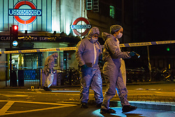 Forensics investigators work at the scene where a seventeen-year-old , the second teenager in less than 24 hours, was stabbed and died outside Clapham South Underground Station. Clapham South, London, November 02 2018.