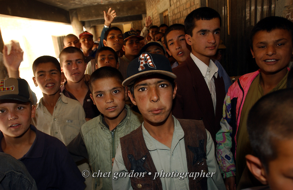 "Afghan boys waiting to enter the dining area at the Tahieya Maskan Orphanage for boys on Saturday, May 25, 2002. A humanitarian mission organized by The Geshundheit Instititute, founded by Dr. Hunter ""Patch"" Adams, Lufthansa Cargo, and DHL Worldwide Express collaborated to ship medicines, food and orthopedic supplies to the Indira Ghandi Children's Hospital, clinics and orphanages in Kabul. The German NGO (Non Governmental Organization) Hammer Forum supervised the distribution of the donated supplies from various non-profit organizations in the U.S. and The Netherlands."