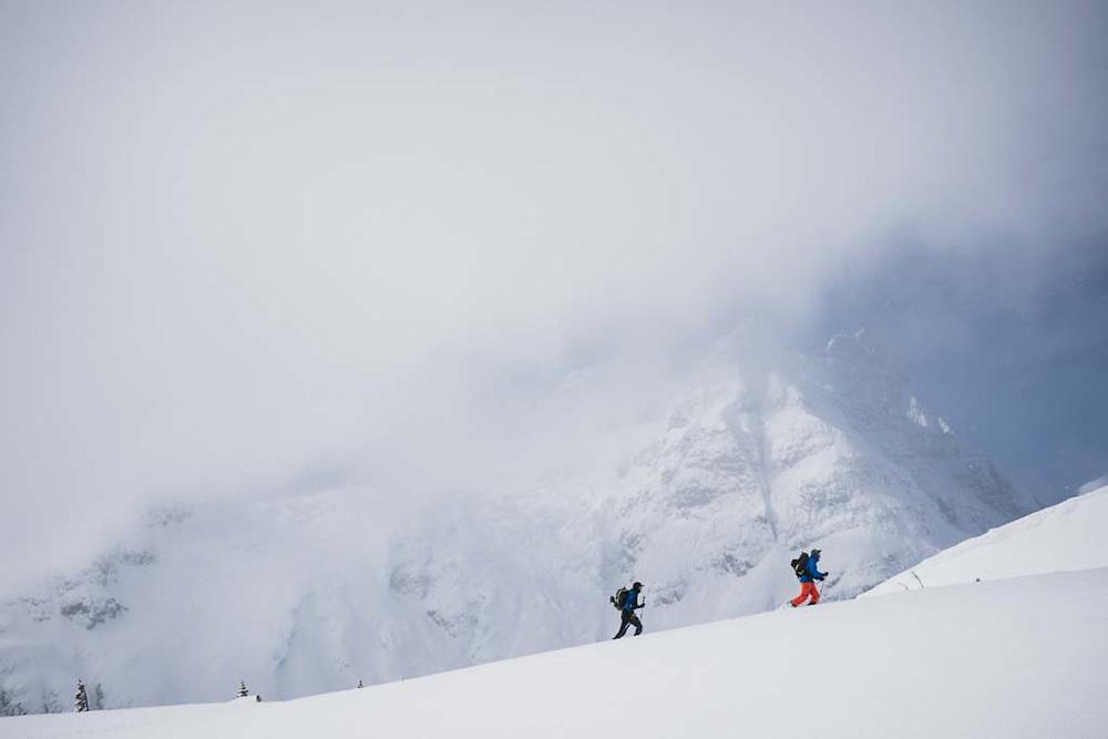 Joe Morabito and Simon Thomson skinning in front of the Polemic Glacier , Howson Range, British Columbia.