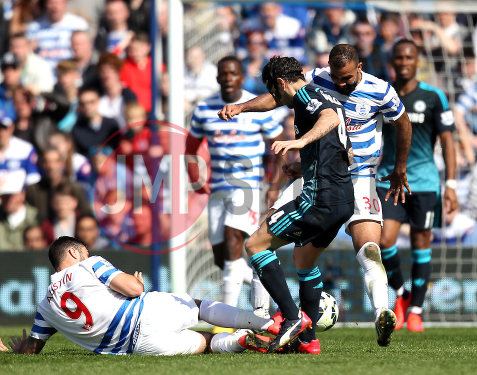 Queens Park Rangers's Charlie Austin tackles Chelsea's Cesc Fabregas - Photo mandatory by-line: Robbie Stephenson/JMP - Mobile: 07966 386802 - 12/04/2015 - SPORT - Football - London - Loftus Road - Queens Park Rangers v Chelsea - Barclays Premier League