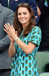 Image licensed to i-Images Picture Agency. 06/07/2014. London, United Kingdom. Duchess of Cambridge applauds Federer fourth set win at the Wimbledon Men's Final.  Picture by Andrew Parsons / i-Images