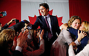 Liberal Party leader Justin Trudeau waves while accompanied by his wife Sophie Gregoire (2nd from R) as he arrives to give his victory speech after Canada's federal election in Montreal, Quebec, October 19, 2015.  REUTERS/Jim Young