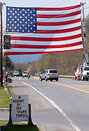 Stone Ridge, New York  - A large American flag hangs over Route 209, where the public lined up to honor U.S. Army Sgt. Shawn M. Farrell II on May 7, 2014. Farrell died April 28 when forces attacked his unit with small arms fire in Afghanistan.