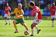 London - Saturday, April 17th 2010: Christian Dailly of Charlton Athletic and Stephen Hughes of Norwich City during the Coca Cola League One match at The Valley, Charlton...(Pic by Alex Broadway/Focus Images)