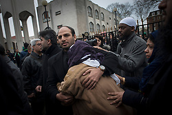 Dr. Abbas Khan Funeral. Fatima Khan, mother of  Abbas Khan cries as she leaves the funeral of Dr Abbas Khan in Regent's Park Mosque, the doctor who died while being held in custody in Syria.Regent's Park Mosque, London, United Kingdom. Thursday, 26th December 2013. Picture by Peter Kollanyi / i-Images