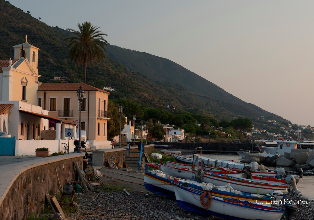 Fishing boats on the rocky beach in Lingua, Salina, The Aeolian Islands, Sicily, Italy
