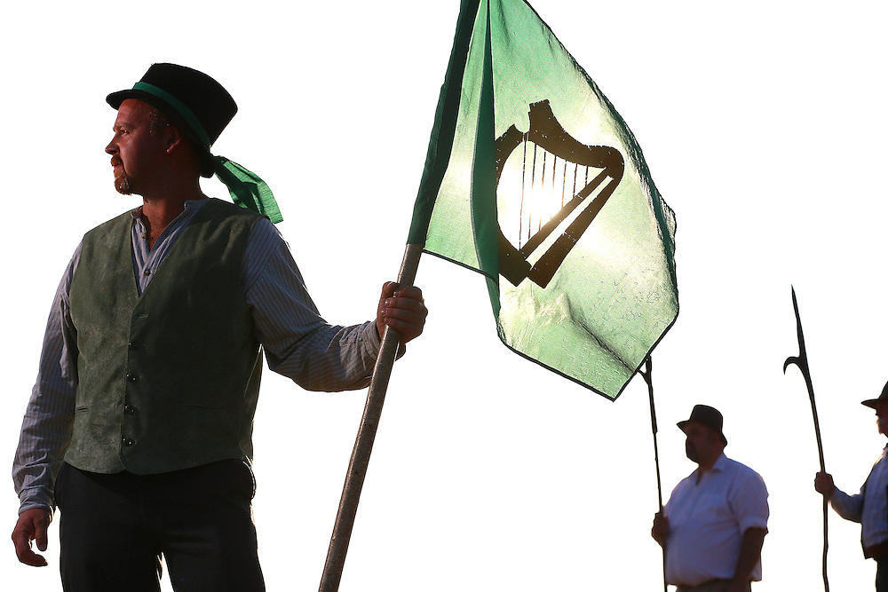 14/07/2013. Free To Use Images. Battle of Vinegar Hill. Pictured at Vinegar Hill, Enniscorthy, Co. Wexford where the Rebels take to the hill in preparation for the upcoming Vinegar Hill Battle reenactment over the August bank holiday weekend. Pictured is Paul Murphy on Vinegar Hill with the Rebel Flag . Picture: Patrick Browne<br />  <br />  For immediate release<br />  <br /> Re-enactment of 'Battle of Vinegar Hill' to Commence<br /> <br /> Join the Pikemen Rebels<br />  <br /> The second annual reenactment of the Battle of Vinegar Hill is set to take place at the historic Enniscorthy location over the August bank holiday weekend.<br />  <br /> Organisers are expecting crowds of over 5,000 to take to the battlefield to enjoy a spectacle of Redcoats and Rebels re-enacting history scenes from 1798 with professional re-enactors from Ireland, England, Scotland, Northern Ireland, and further afield planning their assault on the rebel positions. While the rebel forces are growing larger every day with aspiring insurgents volunteering to take part, the sign up date is still open for the public wishing to join the ranks.<br />  <br /> On Saturday August 3 a Rebel encampment will take over the grounds of the National 1798 Rebellion Centre in Enniscorthy with Rebel commanders on the lookout for talented young Pikemen and women to train before the ensuing fight.  The Blacksmith will also be on hand, shoeing horses, making pikes, swords and other weapons for the upcoming battle and demonstrating the age-old skills.<br />  <br /> If joining the Rebels doesn't take your fancy, joining the ranks of the Redcoats just might.  A plan is afoot for them to commandeer Enniscorthy Castle and demonstrate infringement punishments such as floggings. The Redcoats will be revealing their battle plans to their fellow Generals and the public the day before the battle commences. The highpoint of the day will be a skirmish between the Rebels and Redcoats at 1pm at Duffry Gate to Market Square which will recreate the insurgents' initial capture of Enniscorthy Town in 179