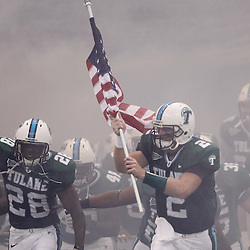 Sep 11, 2010; New Orleans, LA, USA; Tulane Green Wave quarterback Kevin Moore (2) holds an American flag as he leads his team onto the field prior to kickoff of a game between the Mississippi Rebels and Tulane Green Wave at the Louisiana Superdome.  Mandatory Credit: Derick E. Hingle