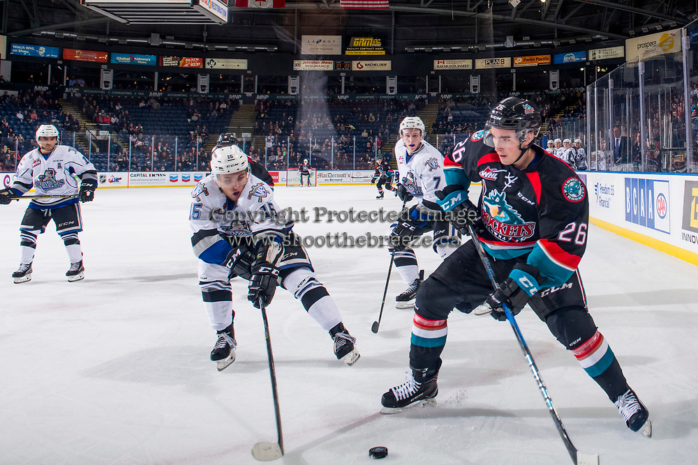 KELOWNA, CANADA - OCTOBER 5: Igor Martynov #15 of the Victoria Royals stick checks Liam Kindree #26 of the Kelowna Rockets in the corner on October 5, 2018 at Prospera Place in Kelowna, British Columbia, Canada.  (Photo by Marissa Baecker/Shoot the Breeze)  *** Local Caption ***